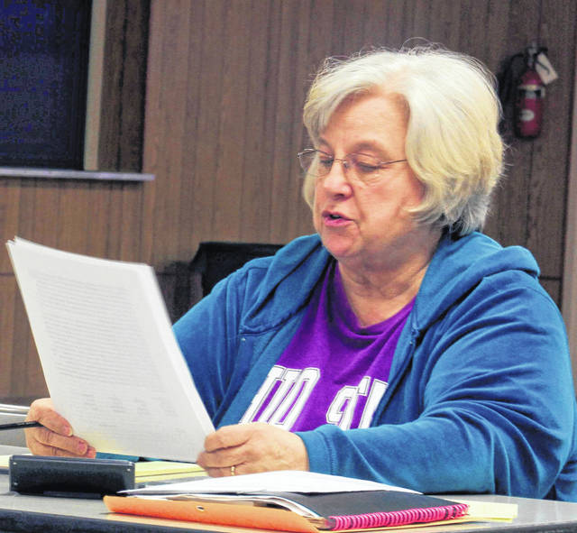 Village of Port Jefferson Fiscal Officer/Secretary Judy Fair reads the minutes from the most recent council meeting outlining the steps the mayor and council has taken on installing shut-off valves on the sewage lines of residents who have not paid their bills. The village will soon be shutting off sewer services to those with delinquent accounts.