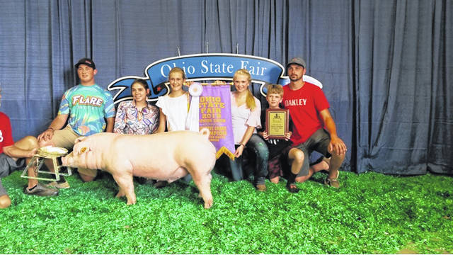 Sable Ruhenkamp won the Reserve Champion Chester hog during the 2019 Ohio State Fair. Pictured are, left to right, Jake Fogt, Summer Oaks, Sable Ruhenkamp, Iris and Bode Ruhenkamp and Frank Riethman.