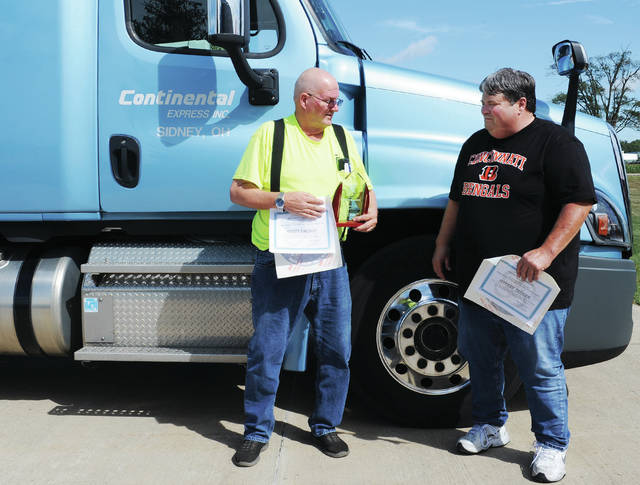 Scott Balogh, left, of Delphi, Indiana, was awarded for driving 1 million miles accident free, and Jeffrey Tedder, of Lima, was awarded for driving 3 million miles without an accident for Continental Express, Inc.