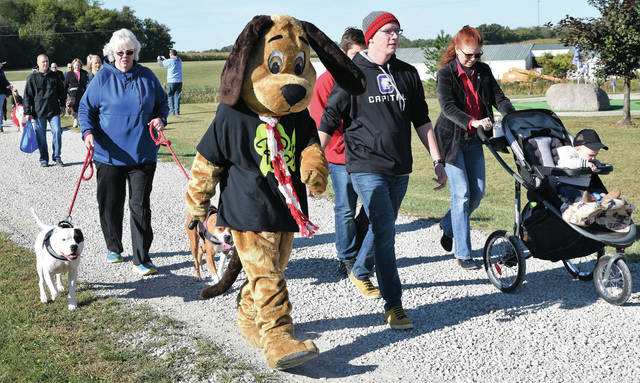 Scarfy leads the pack as dog owners from the area walk their pets in the ҷth Annual Walk to End Parvo, held at Vandemark Farms Saturday, Oct. 5.