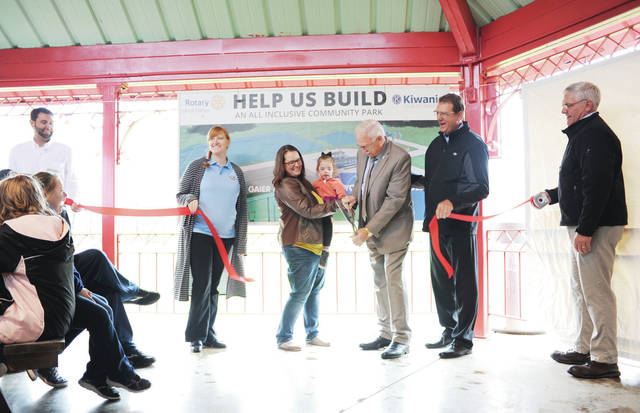A ribbon cutting is held for an inclusive play area on Thursday, Oct. 31. The play area is located next to Geib Pavilion in Tawawa Park. The ribbon cutting was held inside Geib Pavilion due to weather conditions.