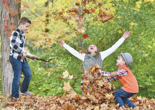 Playing in a pile of leaves at Tawawa Park on Wednesday, Oct. 16 are, left to right, Maxon Newman, 8, Layla Newman, 10, and Holden Newman, 3, all of Weston, Fla.. The kids have been in the area visiting their grandparents, Karen and Jerry Pawlaczyk, who live in Anna. The siblings' mother, Karen Newman, brought the kids to the park for some cell phone photos of them with the fall leaves. Carefully posed photos eventually gave way to a running leaf battle as Newman continued to click shots of the action. The siblings are also the children of Justin Newman.