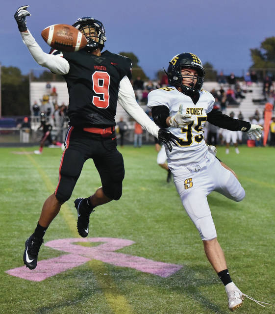 Sidney's Curtis Spangler breaks up a pass to West Carrollton's Jorden Berry during a Miami Valley League game on Friday at West Carrollton's DOC Stadium. The Yellow Jackets will try to win consecutive games for the first time this season when they host Stebbins on Friday.