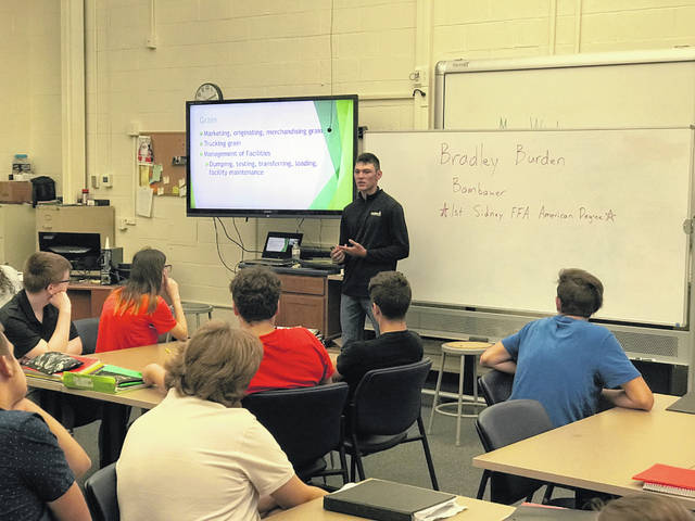 Bradley Burden, former Sidney FFA member and officer, had the opportunity to talk to current agricultural students about his career in agriculture. Burden described his job at Bambauer Fertilizer & Seed and discussed all the career opportunities at Bambauer and across the ag industry. In 2017 Burden became the first Sidney FFA member to receive the American Degree. He is currently studying Ag Business Management at the University of Northwestern Ohio.