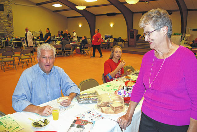 Shelby County Board of Commissioners President Tony Bornhorst enjoys a sandwich after contributing to the Oct.15 blood drive at St. Michael's Hall in Fort Loramie.