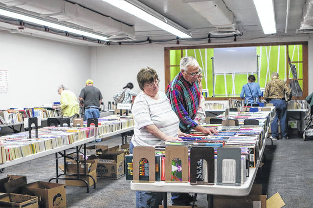 Cindy Werts, of Sidney, and Ken Monnin, of Minster, look through the books at the annual Amos Memorial Library book sale which is underway. The book sale runs through Saturday, Oct 12. Hours are 11 a.m. to 6 p.m. Wednesday to Friday and 11 a.m. to 4 p.m. on Saturday.