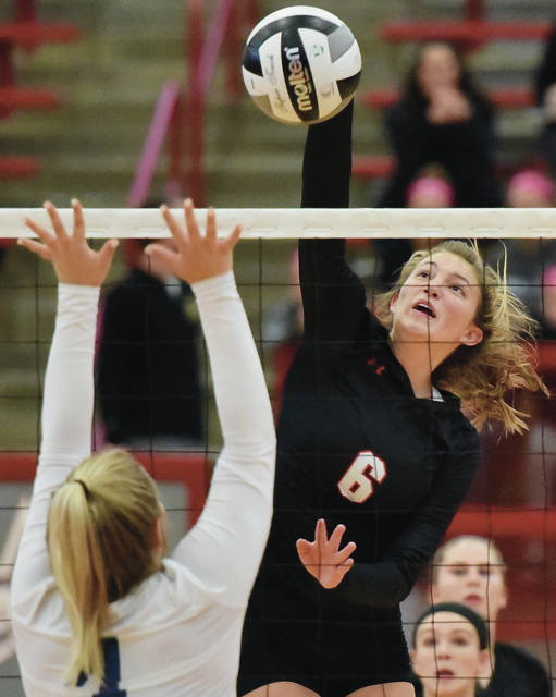 Fort Loramie's McKenzie Hoelscher spikes as Cincinnati Country Day's Alexa Bailey defends during a Division IV district final against Cincinnati Country Day on Saturday at Troy High School's Trojan Activities Center. Hoelscher had 17 kills in the Redskins' 3-0 victory, which earned the program its 12th consecutive district title.