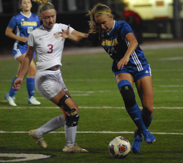 Lehman Cathlic's Noelle Dexter fights off Middletown Madison's Olivia Kraft as she moves towards the goal during a Division III district semifinal on Monday night at Wayne High School's Heidkamp Stadium.
