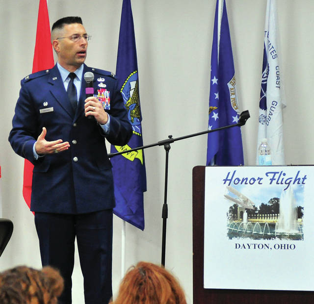 Guest speaker, Col. Thomas Sherman, Commanding Officer of the 88th Air Base Wing, Wright-Patterson Air Force Base, gives an inspiring talk during the Honor Flight Dayton 2019 reunion at the Clark County Fairgrounds on Sunday. The event was attended by more than 900 veterans and their family members.