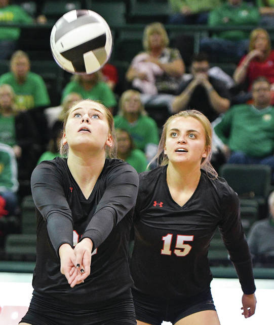 Fort Loramie's Marissia Meiring bumps as Alyssa Wrasman watches during a Division IV state semifinal against Newark Catholic on Friday at Wright State University's Nutter Center.