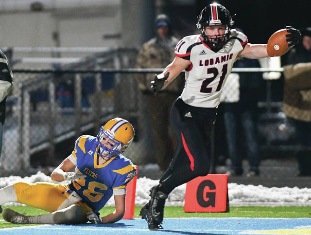 Fort Loramie junior Nate Meyer crosses the end zone on a 22-yard TD reception after evading Marion Local's Blake Schwieterman in the first quarter of a Division VII, Region 28 semifinal on Saturday at Grand Lakes Health System Field in St. Marys.