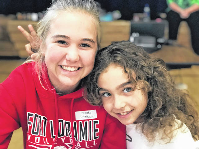 Big Buddy Brook Holthaus, of Fort Loramie, enjoys a fun moment with her Little Buddy Carly at a session. Match Day gifts support the Big Buddies program.