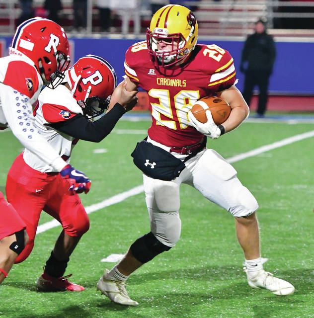 New Bremen's Zach Bertke evades Lima Perry defenders during a Division VII, Region 28 semifinal on Saturday at Alexander Stadium in Piqua. The Cardinals will face MAC rival Marion Local on Saturday in Wapakoneta.