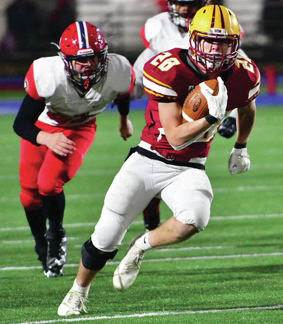 New Bremen's Zach Bertke runs during a Division VII, Region 28 semifinal on Saturday at Alexander Stadium in Piqua. Bertke ran for 11 yards and two touchdowns on seven carries.