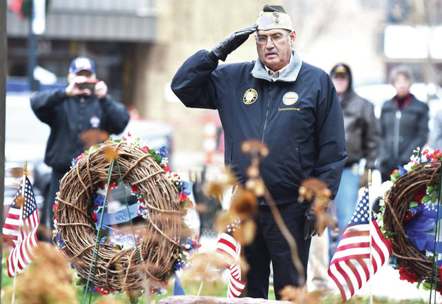 Sidney VFW Commander Thomas Kinninger, of Sidney, salutes after placing a wreath during Veterans Day Services on the courtsquare on Monday, Nov. 11.