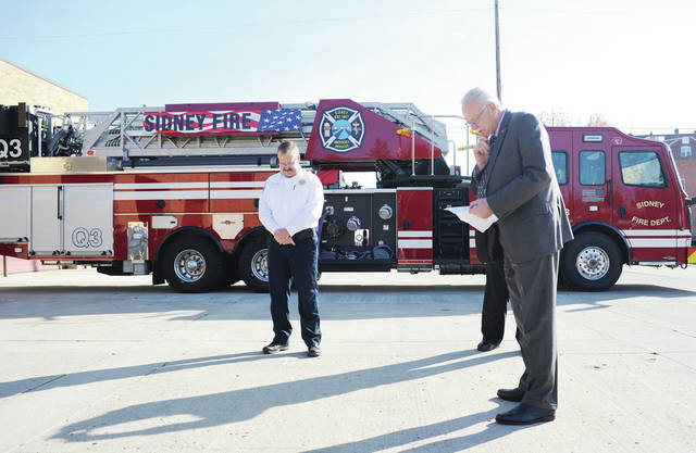Mayor Mike Barhorst says a prayer during the dedication of Quint 3.