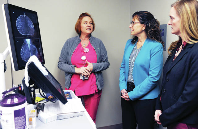 Mammography Technologist Tina Bryant, left to right, of Sidney, shows what a technician sees on a screen while giving someone a 3D mammogram at Wilson Health. Listening are Vice President and General Manager of purchasing at Honda of America Pam Heminger, of Dublin, and Honda Planning and Communication Coordinator Carla Greene, of Bellefontaine. Honda representatives were taken on a tour, Thursday, Nov. 21, of the new mammography technology their company helped Wilson Health purchase.