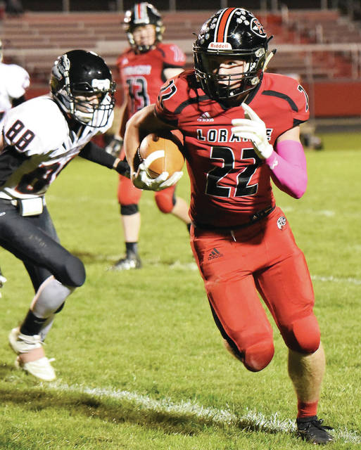 Fort Loramie's Damon Mescher runs around Mississinawa Valley's Cameron Shimp during a Cross County Conference game on Oct. 18. The Redskins will face Marion Local in a Division VII, Region 28 semifinal on Saturday at St. Marys' Alumni Field.