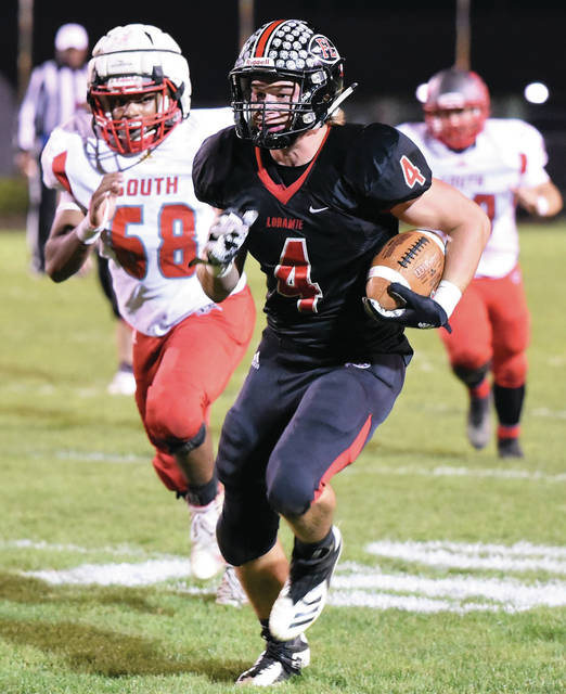 Fort Loramie's Nick Brandewie runs during a Cross County Conference game against Twin Valley South on Oct. 25 at Redskin Stadium. Brandewie is one of three players that have over 250 receiving yards this year.
