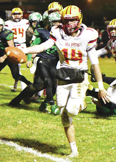 New Bremen quarterback Mitchell Hays runs into the end zone for a touchdown during a Division VII regional quarterfinal against New Miami on Saturday in Hamilton.