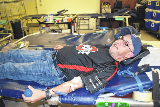 Dan Francis donates blood at the annual OSU Alumni Club of Shelby County and Farm Bureau Women's Committee Buckeye Blood Drive on Nov. 19 at the Sidney American Legion Post.