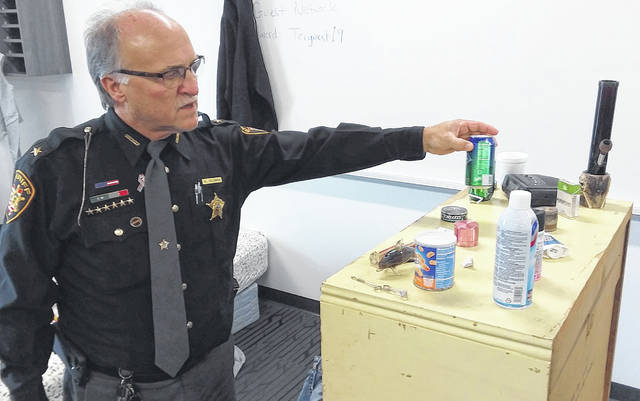 Auglaize County Sheriff Al Solomon checks out the Hidden in Plain Sight room at the Drug Symposium, held Sunday, at Tri-Star.