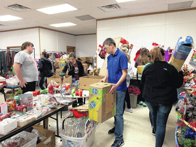 Members of the Anna FFA helped at FISH Thrift Shop as part of a community service project.