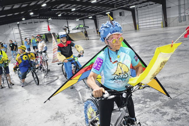 "Connie Ziegler, from Kenton, takes part in the Great Ohio Bicycle Adventure parade on June 15 inside the Pavilion at the Wood County Fairgrounds. Ziegler's theme was ""land, water and air,"" which won her first place. GOBA will start and finish in Sidney in 2020, and the city will host the bicycling costume contest, a parade to downtown and a festival with arts, music and food."