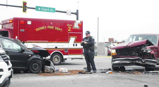 A head-on collision at the intersection of Court Street and Fourth Avenue in Sidney slowed down traffic Tuesday afternoon. According to the Sidney Police Department, a black Chevrolet Aveo traveling southbound on Fourth Avenue and a red Ford F-150 traveling northbound on Fourth Avenue crashed into each other. Both vehicles were hauled away by wreckers.