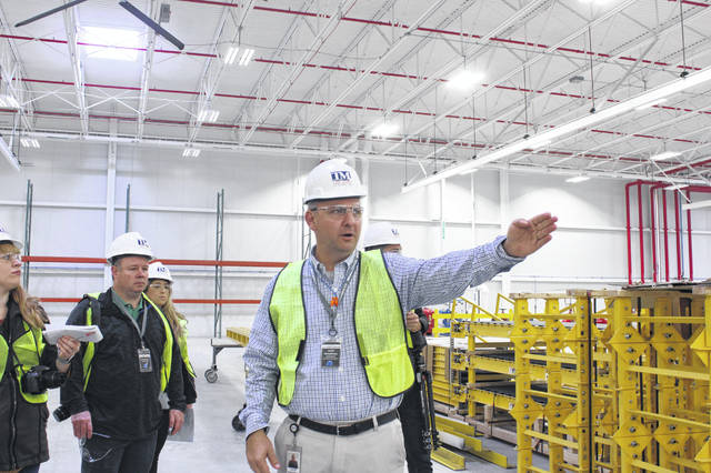 Airstream COO Justin Humphreys points out where manufacturing equipment and stations will be set up in the new Airstream manufacturing facility, located at 1001 W. Pike St., Jackson Center.