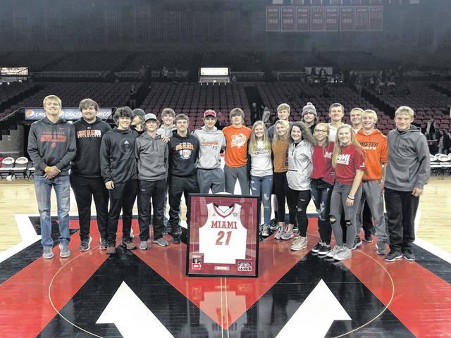 Jackson Hogenkamp's family and friends accepted a framed No. 21 Miami University jersey in his memory during a ceremony Nov. 9 in Oxford.