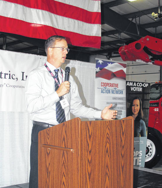 Matt Berry, CEO of Midwest Electric Inc., welcomes attendees to the political action and customer appreciation breakfast held in St. Marys Wednesday morning.