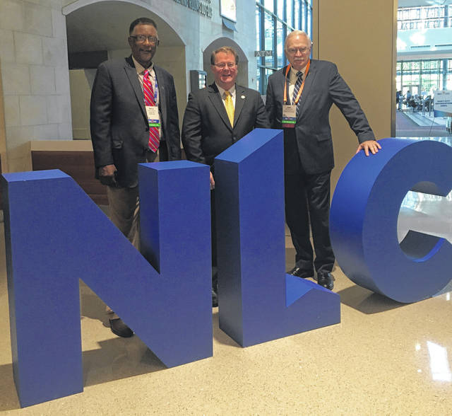 Tupelo, Mississipi, Council member Willie Jennings, left to right, and Tupelo Mayor Jason Shelton pose with Sidney Mayor Mike Barhorst at the National League of Cities City Summit held this past week in San Antonio after discussing the lack of affordable housing and a trained workforce.