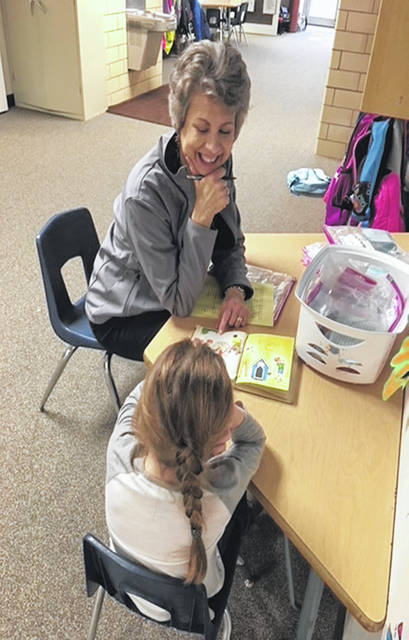 POWER member Mary Beth Monnier of Sidney tutors children as part of the group's activities.