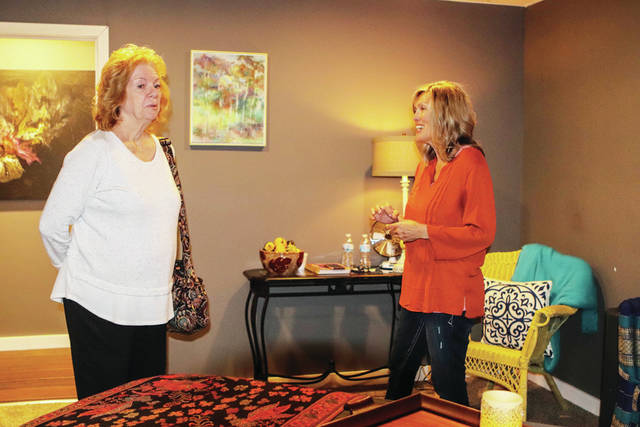 Cheri Dalton, left, with the Sidney-Shelby County Chamber of Commerce, and massage therapist Sonja Nicodemus look at the massage room during the Moonflower Aromatherapy and Salt Room and Therapeutic Massage by Sonja ribbon cutting event.