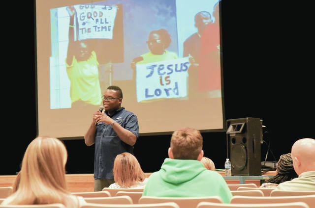 Bevin Stanislaus, Grenada, who represents Fellowship of Christian Athletes, speaks to students in the auditorium at Anna High School Sunday, Nov. 10 evening. Bevin Stanislaus is hoping to expand his ministry to 200 coaches, 10,000 athletes , and 20 communities in Grenada.
