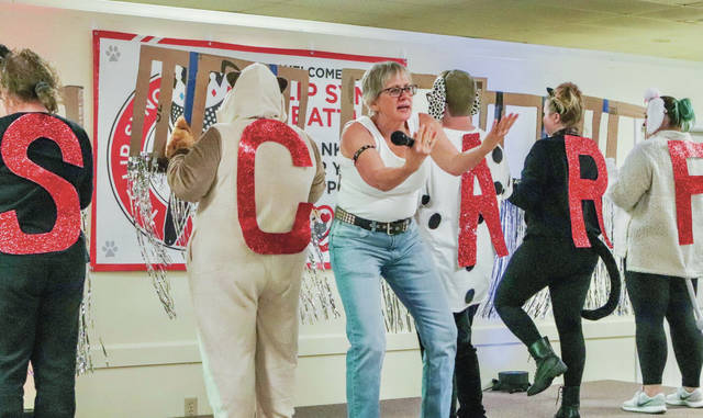 Dr. Kelley A. Young a veterinarian from Stonyridge Veterinary Services performs during Scarf's Lip Sync Battle on Sunday, Nov. 10.
