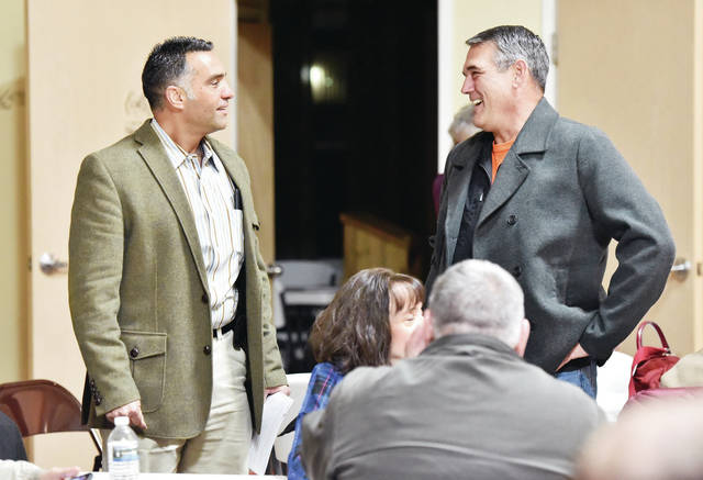State Rep. Nino Vitale, left, talks with Dan Cecil, of Sidney, at a Shelby County Liberty Group Town Hall event held at United Calvary Baptist Church on Thursday, Nov. 14.