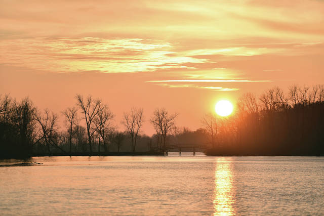 The sun sets on Lake Loramie Sunday, Nov. 24 as viewed from Filburns Island boat ramp and picnic area.