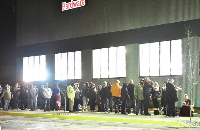 A line of people stretches along the front of Menards at 5:30 a.m.. The people were waiting for the doors to open at 6 a.m. so they could get to Black Friday deals on Friday, Nov. 29.