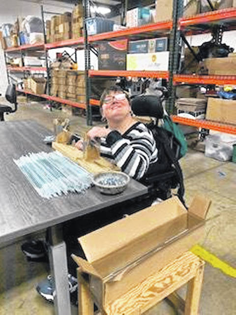 S&H Products associate Tina M. loves the adjustable tables so she can sit up comfortably to work. More tables and other items will be purchased with 2019 Match Day gifts.