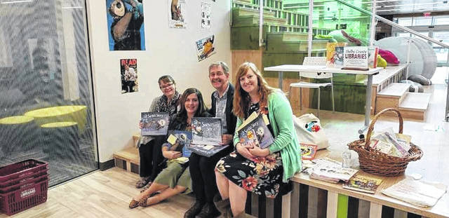 Staff members, left to right, Missy Rivera, April Orsborne and Rikki Unterbrink recently visited with children's author Will Hillenbrand, third from left, at the Amos Memorial Library. Author receptions were supported by 2018 Match Day gifts.