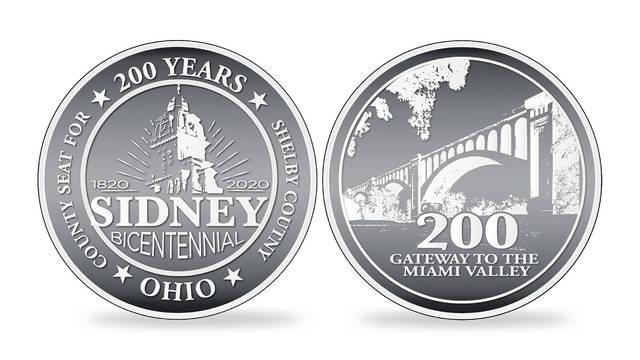 "The design of the 1.54-inch diameter coin that will be produced and sold celebrating Sidney's Bicentennial includes an image of the Big-Four Bridge, the clock tower of the Shelby County Courthouse and the fact that Sidney is the county seat of Shelby County and the ""Gateway to the Miami Valley."""