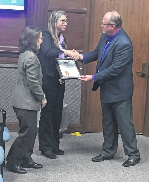 Finance Officer Ginger Adams, left, and Assistant Finance Officer Renee DuLaney, center, receive the Ohio Auditor of State Award with Distinction from Joe Braden, Western Regional Liaison with the Ohio Auditor of State's office Monday night during the Sidney City Council meeting. The award was given to the city of Sidney for the audit of year ending Dec. 31, 2018. Sidney has received the Ohio Auditor of State Award since 2004.