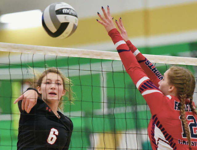 Fort Loramie's McKenzie Hoelscher spikes against Lancaster Fairfield Christian Academy's Olivia Koehler during a Division IV regional semifinal on Thursday at Northmont High School's Thunderdome.