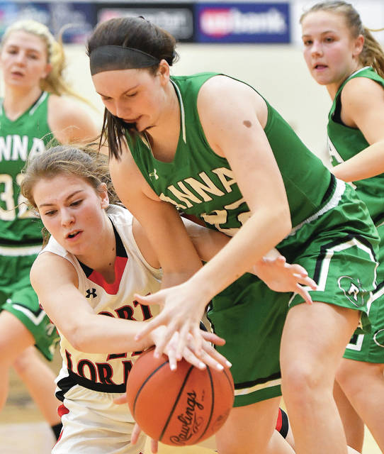 Fort Loramie sophomore forward Ava Sholtis fights for a rebound with Anna's Lenna Rowland during the second half of a Shelby County Athletic League game on Saturday in Fort Loramie.