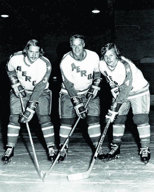 Gordie Howe, center, is flanked by sons Marty, left, and Mark in their Houston Aeros uniforms in St. Clair Shores, Mich., in 1973.  Associated Press file photo