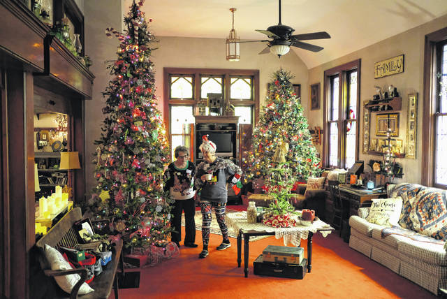 "Doug and Miriam Martin inside their home that was the former Pemberville Presbyterian Church on Ohio 105 and Ohio 199. The couple call the home their ""chouse"" and open it up for tours during the holiday season."