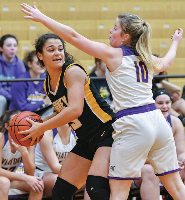 Sidney freshman guard Allie Stockton,, left, looks for a teammate to pass to with pressure from Butler's Gracie Price during the first half of a Miami Valley League game on Saturday in Vandalia. Stockton led the Yellow Jackets with 21 points and eight rebounds.