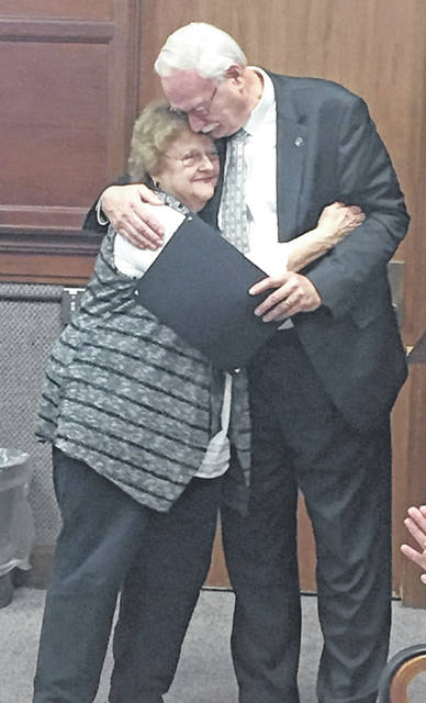 Janet Born hugs Mayor Mike Barhorst after being presented with a plaque and copy of a resolution commending her years of service as a Sidney City Council member during her last council meeting, Monday, Nov. 25. Born served seven and a half years as a City Council member.